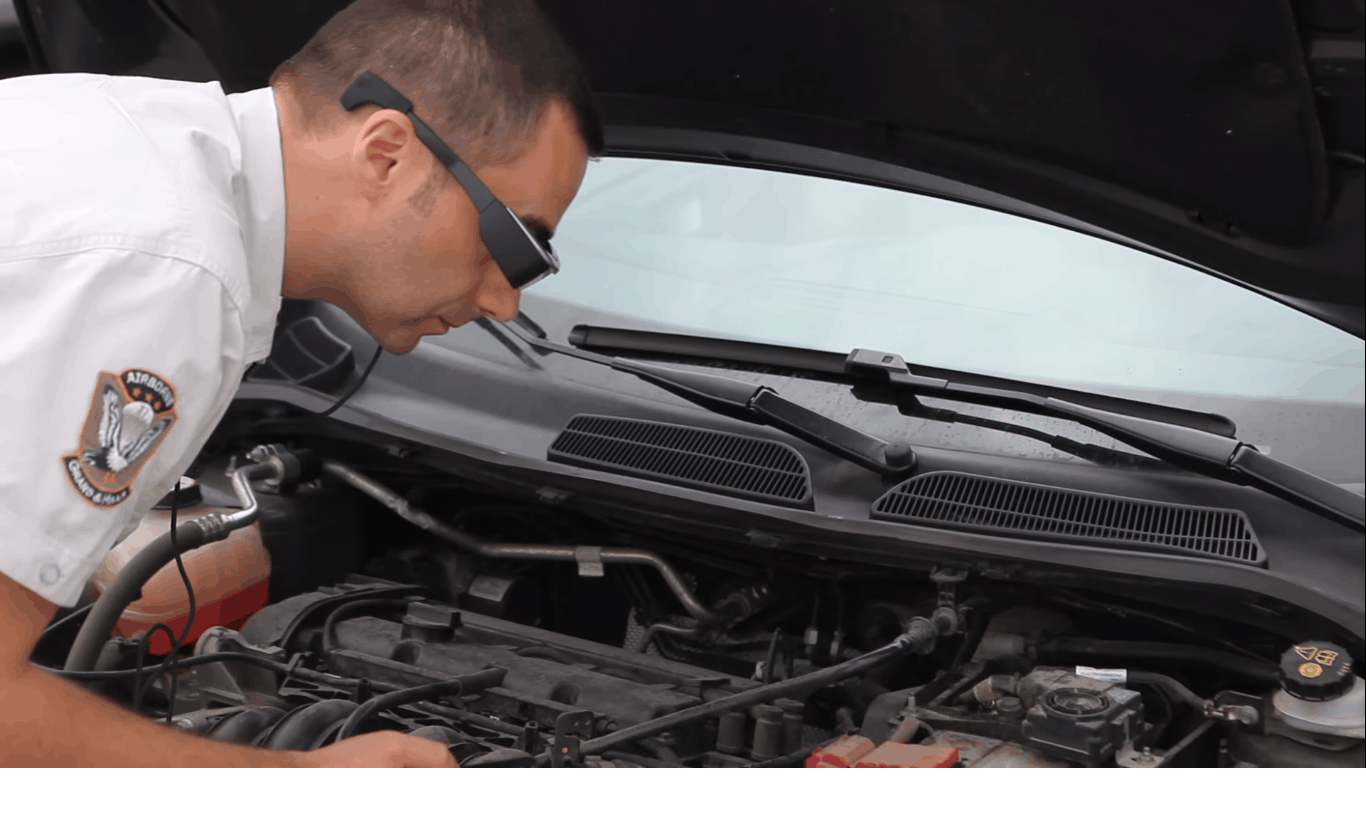 Man using Epson Moverio Smartglass to diagnose car engine