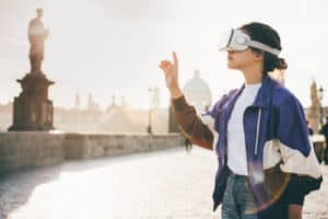 Woman wearing vr headset augmented virtual reality in history city center