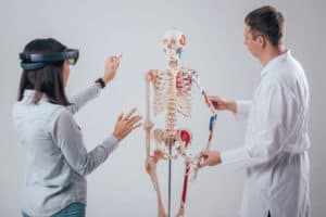 Doctors using Microsoft Hololens for Augmented Reality on skeleton