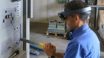 Worker using AR headset HoloLens for work instructions