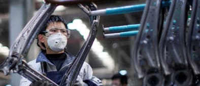 worker with face mask in a factory