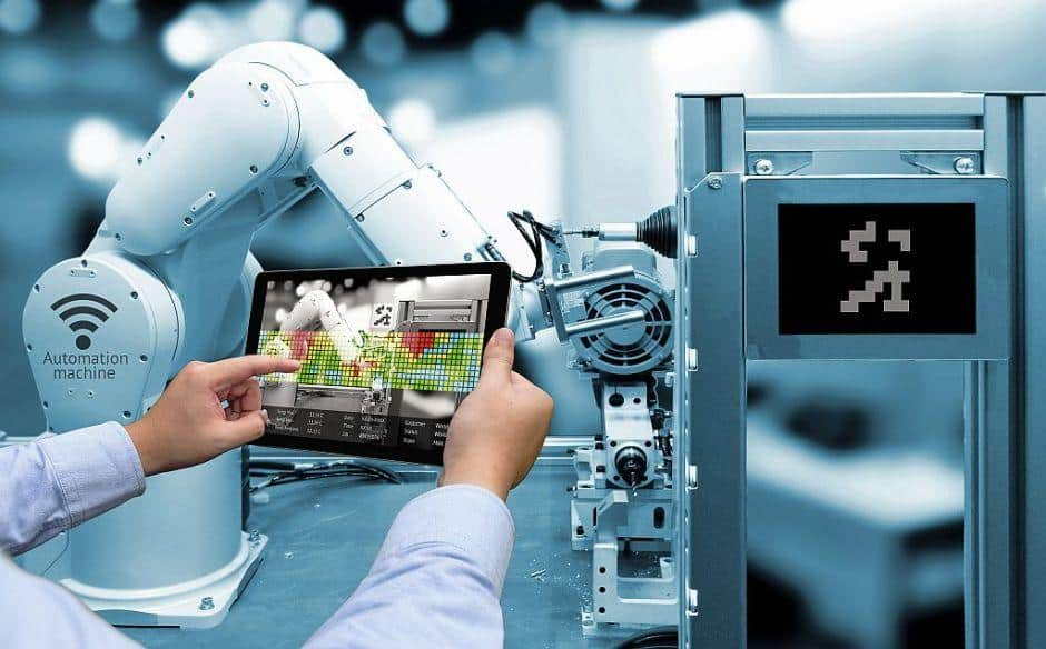 worker in a factory using a tablet for smart maintenance tasks