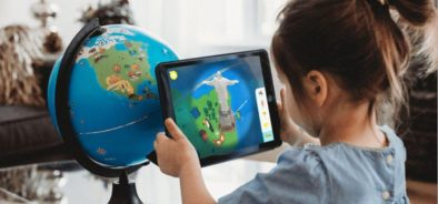 children using tablet to view an augmented reality globe