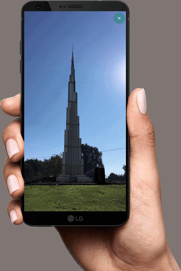 Hand holding smartphone with AR Burj Khalifa