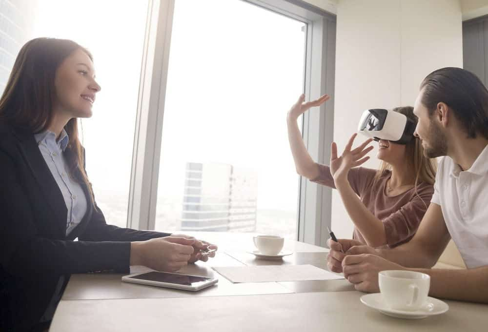 Real Estate agent with clients using VR home tour